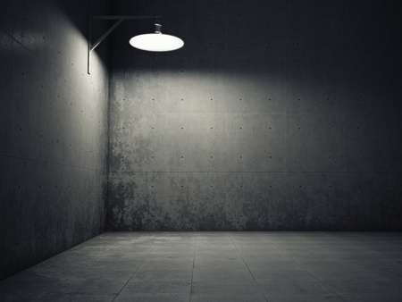 Dirty concrete wall illuminated by lamp photo