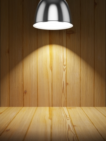 Empty wooden shelf illuminated by lamp photo