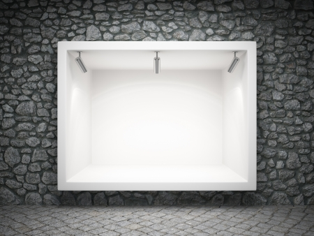 showcase: Empty shop window in the ancient stone wall Stock Photo