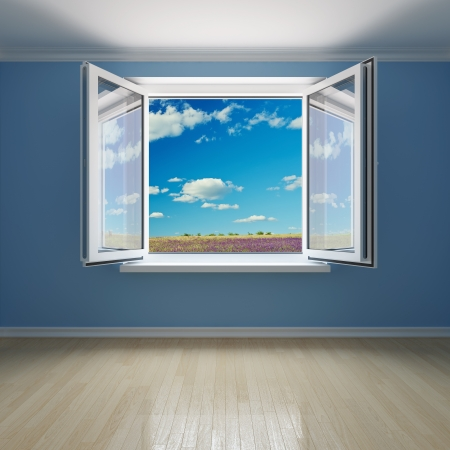 Interior room with open window on meadow with blue sky