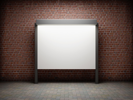 Blank notice board on brick wall photo