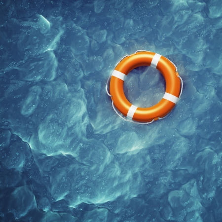 lifebuoy: Lifebuoy in a stormy blue sea Stock Photo