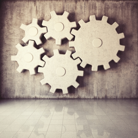 engine room: Large gear mechanism in room with concrete walls Stock Photo