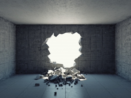 Destroyed wall of concrete structure. Concept of escape to freedom. Stock Photo