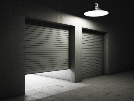 롤러 셔터 문에 콘크리트로 만든 창고 건물