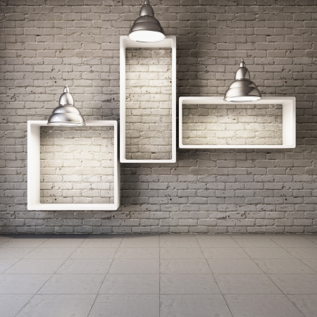 Brick wall with empty shelves and lamps photo