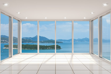 window view: Empty modern lounge area with large bay window and view of sea