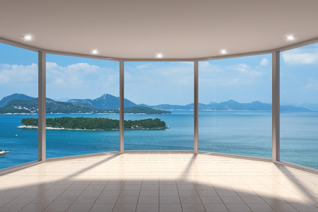large windows: Empty modern lounge area with large bay window and view of sea