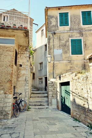 Cute old yard in Croatia. Typical for Mediterranean architecture photo