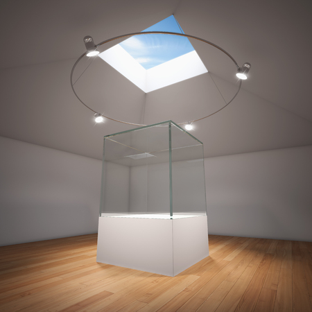 Empty glass showcase in room illuminated by spotlights photo