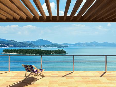 Şezlong ve güzel deniz manzaralı geniş teras