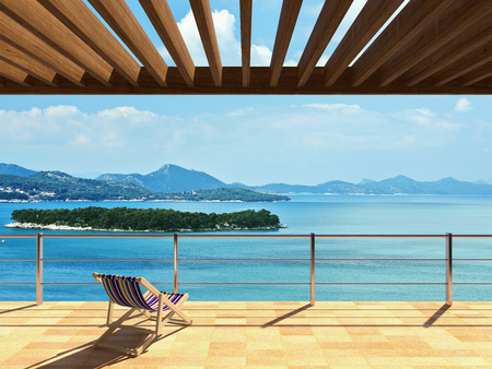 Large terrace with loungers and beautiful sea views 스톡 콘텐츠