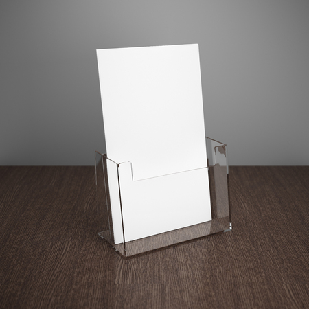 Blank brochure with glass holder on wooden table