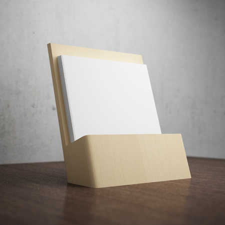 Blank brochure with wooden holder on table