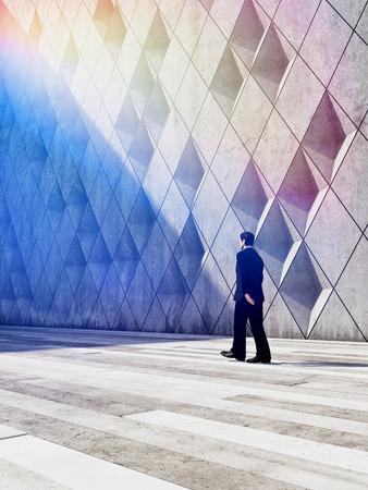 businessman walking: Concept of businessman walking in architectural design buildings. 3D illustration.
