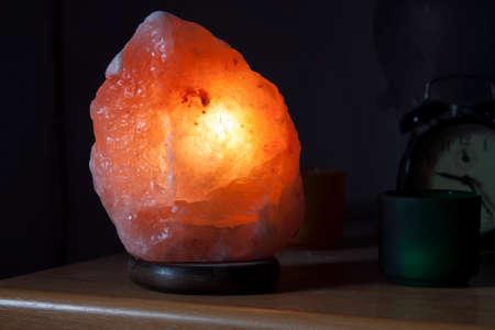 himalayan salt: A lamp made with an Himalayan salt rock turned on.