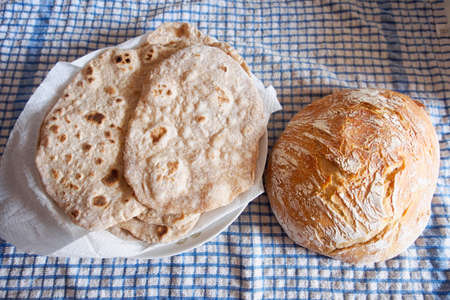 unleavened: Unleavened bread and the typical Italian loaf. Homemade and healthy food. Organic ingredients. Stock Photo