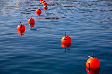 barcolana: Red buoy on the sea for the Barcolana boat race event.