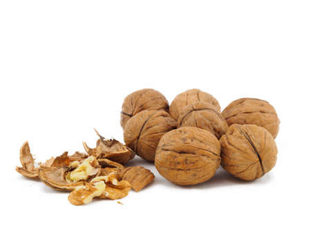 white isolate: Group of walnuts plus a broken one