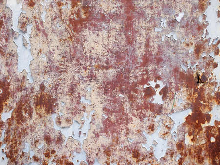 removed: Removed paint on a metallic surface on a great wall. Stock Photo