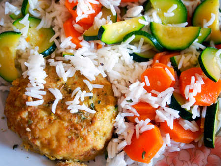 vegetarian hamburger: Food. Homemade millet burger with spices. Basmati rice, carrots and zucchini as side dish.