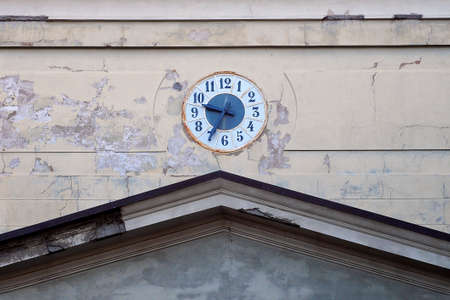 removed: The old clock of a church on the external wall with removed plaster. Stock Photo