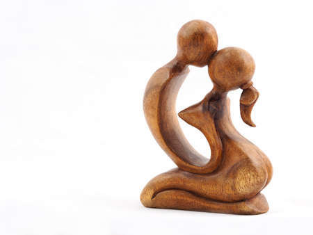 natural love: Kissing. A tiny wooden sculpture of two lovers.