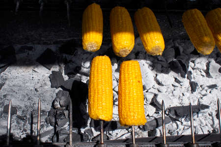 open air: Roasting corn on embers in the open air. Stock Photo