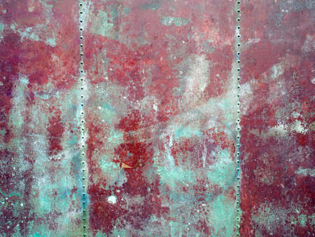 steel texture: Rusty metal surface with green and red colors. Stock Photo