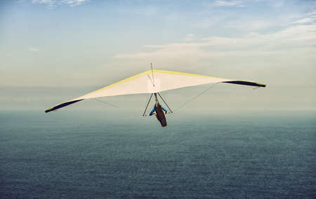 currents: Hang glider in soaring flight off lookout mountain. A glider in flight is continuously descending. the pilot must seek air currents rising Stock Photo