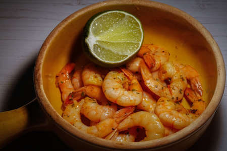 marinated shrimp prawns peeled with slice of lemon