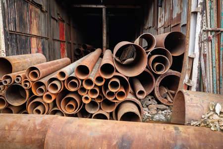 huge industrial rusted iron metal tubes pipes
