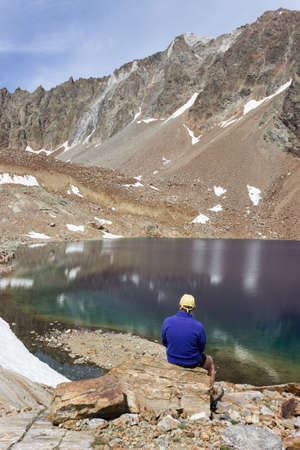 valley view: Hiker Observes the spectacular color of Lac Mort, Valpelline Italy