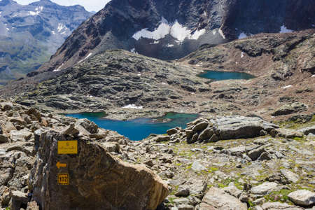 Hiking in Aosta valley, Grauson walloon, Cogne, Italy. Close view of third lake of Lussert from Laures col (3000 m.).