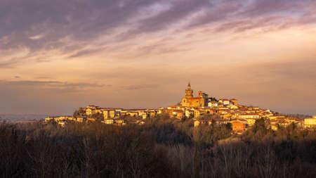 Winter sunset in the Monferrato hills. Village of Camagna, Piedmont, Italy. Peaceful sight.