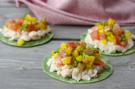 Vegan Mexican Pizzettes. tortillas with mashed white beans, tomatoes and bell peppers photo