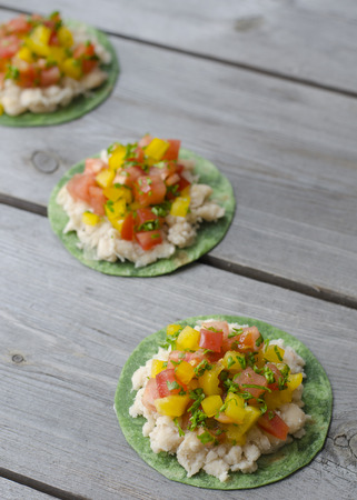 Vegan Mexican Pizzettes. tortillas with mashed white beans tomatoes and bell peppers