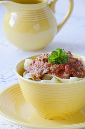 bolognaise: pasta with bolognaise sauce and herbs