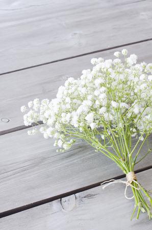Gypsophila flowers on wooden background Stock Photo