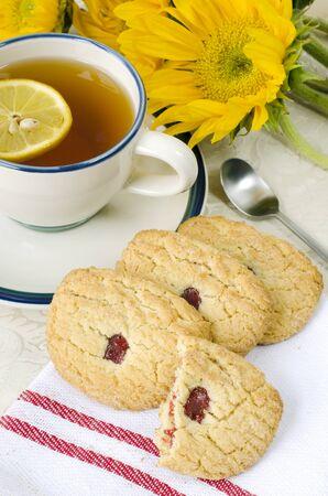 Sugar cookies with lemon tea Stock Photo