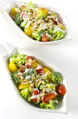 broccoli salad: Broccoli salad with bacon cherry tomatoes and sunflower seeds Stock Photo
