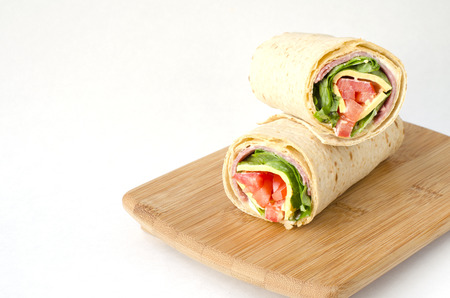 filled out: wrap sandwich with salami, lettuce, tomatoes and cheeses
