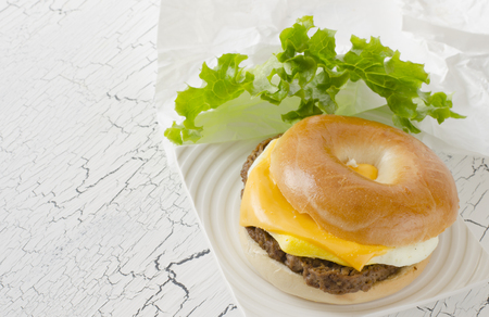 angus: Bagel with angus beef, egg, cheese and lettuce. Stock Photo