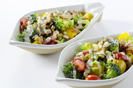 Broccoli salad with bacon cherry tomatoes and sunflower seeds Stock Photo