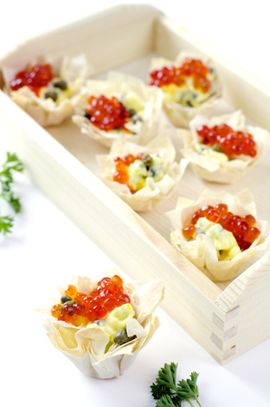 filo: Filo tartlet canapes with red caviar and capers.