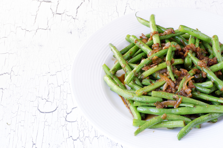 long bean: Green string beans chinese dish with spices. Green beans fried with onion, soy sauce, garlic and spices. Stock Photo