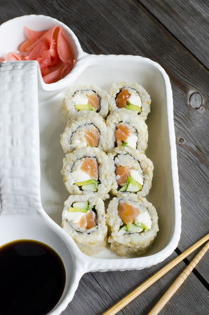 sushi rolls with brown rice, salmon, cucumber, avocado and cream cheese japanese food style 版權商用圖片