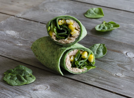 filled out: wrap sandwich with pink salmon, conr, and spinach in spinach wrap Stock Photo