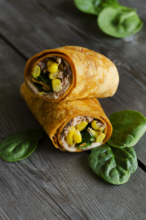 pink salmon: wrap sandwich with pink salmon, conr, and spinach in tomato wrap