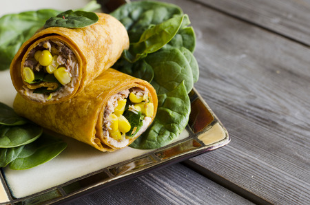 pink salmon: wrap sandwich with pink salmon, conr, and spinach in wrap Stock Photo